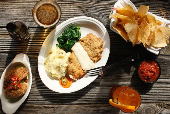 Chicken Fried Steak: Not technically Tex-Mex but too good to leave off the menu: pounded top round, breaded and fried, served with black pepper cream gravy, smashed potatoes, sautéed spinach, and escabeche.
