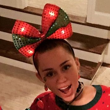 miley cyrus her fianc liam hemsworth and their families are having quite the christmas to do including blinky lights ugly sweaters cozy pajamas - Miley Cyrus Christmas