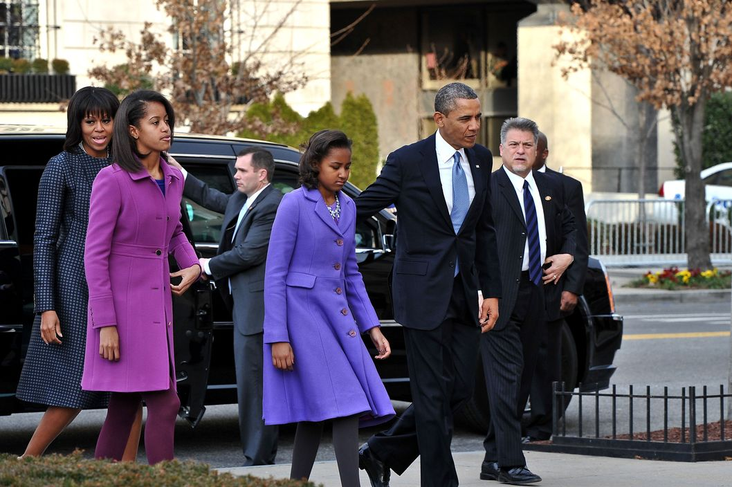 US President Barack Obama, First Lady Michelle Obama and their daughters Sasha(2nd-R) and Malia arrive at St. John's Church on January 21, 2013 in Washington, DC, hours before Obama participates in a ceremonial swearing in for a second term in office.