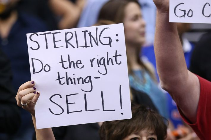 LOS ANGELES, CA - APRIL 29: Los Angeles Clippers hold up signs referencing the Donald Sterling situation before the game with the Golden State Warriors in Game Five of the Western Conference Quarterfinals during the 2014 NBA Playoffs at Staples Center on April 29, 2014 in Los Angeles, California. NOTE TO USER: User expressly acknowledges and agrees that, by downloading and or using this photograph, User is consenting to the terms and conditions of the Getty Images License Agreement. (Photo by Stephen Dunn/Getty Images)