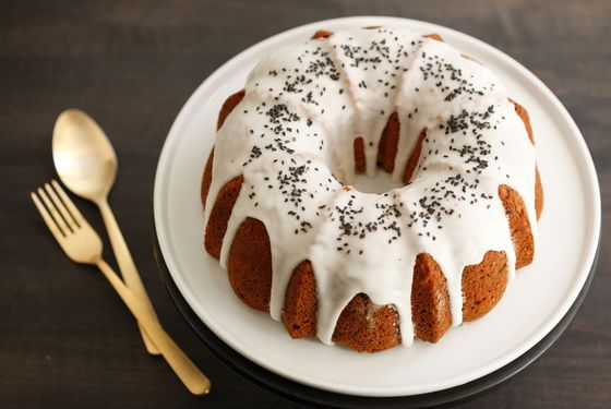 Black sesame, apple, and ricotta bundt cake with lemon glaze.