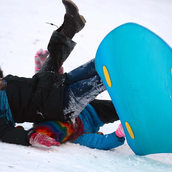 Children sled down at snow covered Central Park after the snow storm in New York, United States, January 22, 2014.