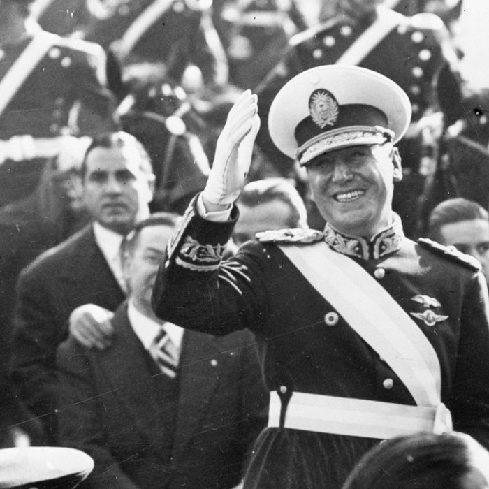 miling broadly, newly-elected President of Argentina Juan Peron stands in the presidential car to wave to the crowds gathered on the Buenos Aires streets to witness the inaugural parade of Argentina's new president. President Peron, who wears the uniform of an Argentine Brigadier General, took the oath of office for a six year term in ceremonies before a Joint Session of the new Argentine Congress on June 4.
