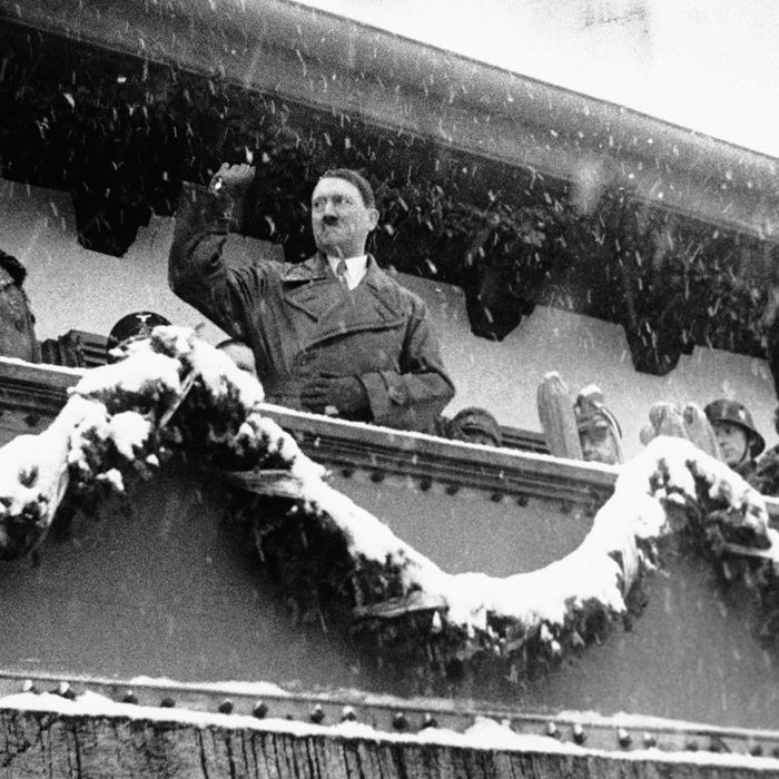 1936, Garmisch-Partenkirchen, Germany --- Adolf Hitler Standing on Balcony at the Winter Olympics --- Image by ? Lucien Aigner/CORBIS