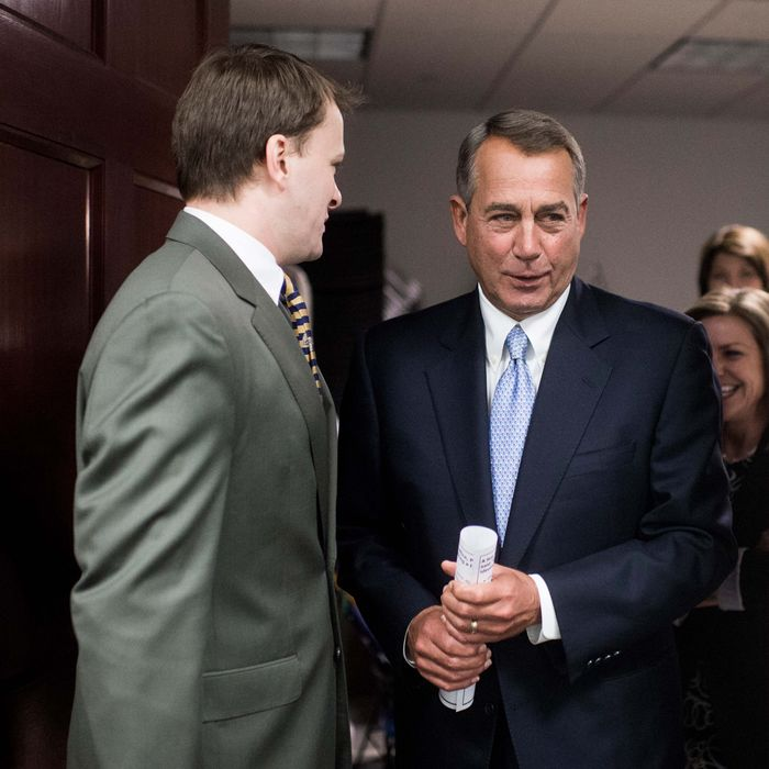 Speaker of the House John Boehner, R-Ohio, leaves the House Republican Conference meeting to address the media in the basement of the Capitol on Tuesday, Feb. 4, 2014.