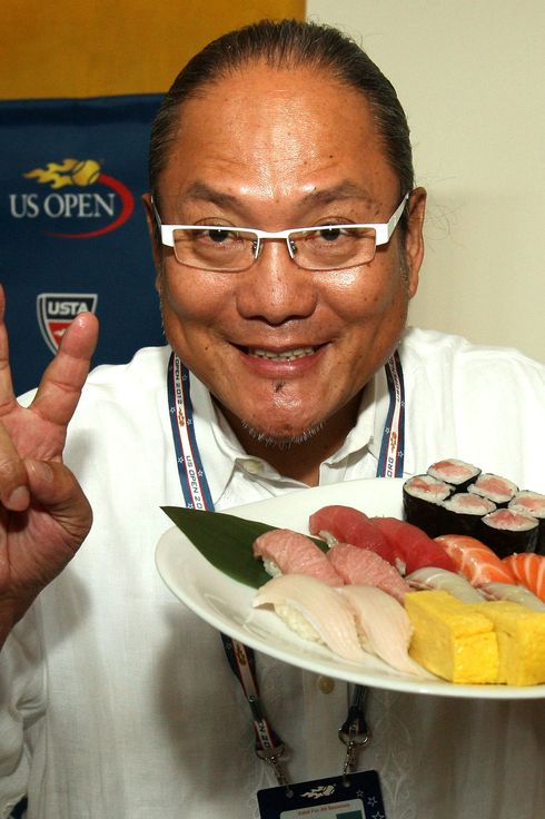 Chef Masaharu Morimoto presents a plate of sushi during a food tasting prior to the start of the 2012 U.S. Open at the USTA Billie Jean King National Tennis Center on August 23, 2012 in the Flushing neighborhood, of the Queens borough of New York City.