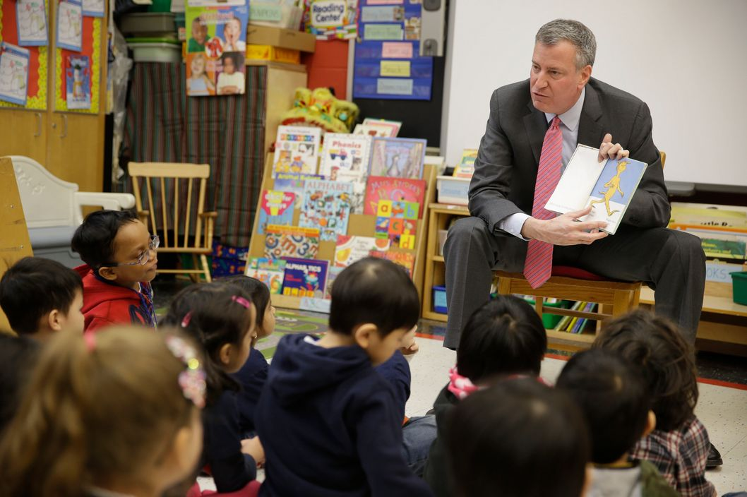 Mayor de Blasio reads to children in a pre-K class at P.S. 130 on February 25, 2014.