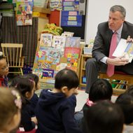 New York City Mayor Bill de Blasio reads to children in a pre-kindergarten class at P.S. 130 on February 25, 2014 in New York City. De Blasio stopped by the classroom after a news conference about his plans for universal pre-kindergarten in New York City.