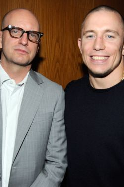 "LOS ANGELES, CA - JANUARY 05:  Director Steven Soderbergh (L) and UFC fighter Georges St-Pierre attend Relativity Media's premiere of ""Haywire"" after party co-hosted by Playboy held at DGA Theater on January 5, 2012 in Los Angeles, California.  (Photo by Frazer Harrison/Getty Images for Relativity Media)"