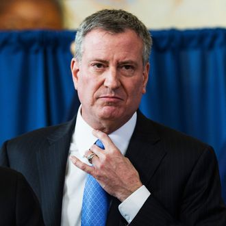 New York City Mayor Bill DeBlasio attends a press conference to announce the city will not appeal a judge's ruling that the police tactic