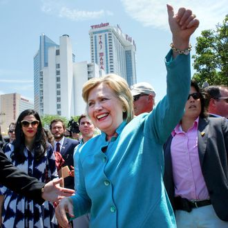 US Democratic presidential candidate Hillary Clinton waves to Members of the Atlantic City casino workers union members outside the Taj Mahal Casino after a event in Atlantic City, New Jersey, on July 6, 2016.