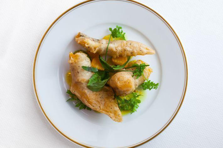 Anguilles frites au sarrasin: buckwheat-fried Delaware eel, curry vinaigrette, herbs, citrus.