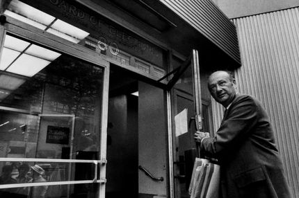 Congressman Ed Koch campaigning entering New York City Board of Elections.