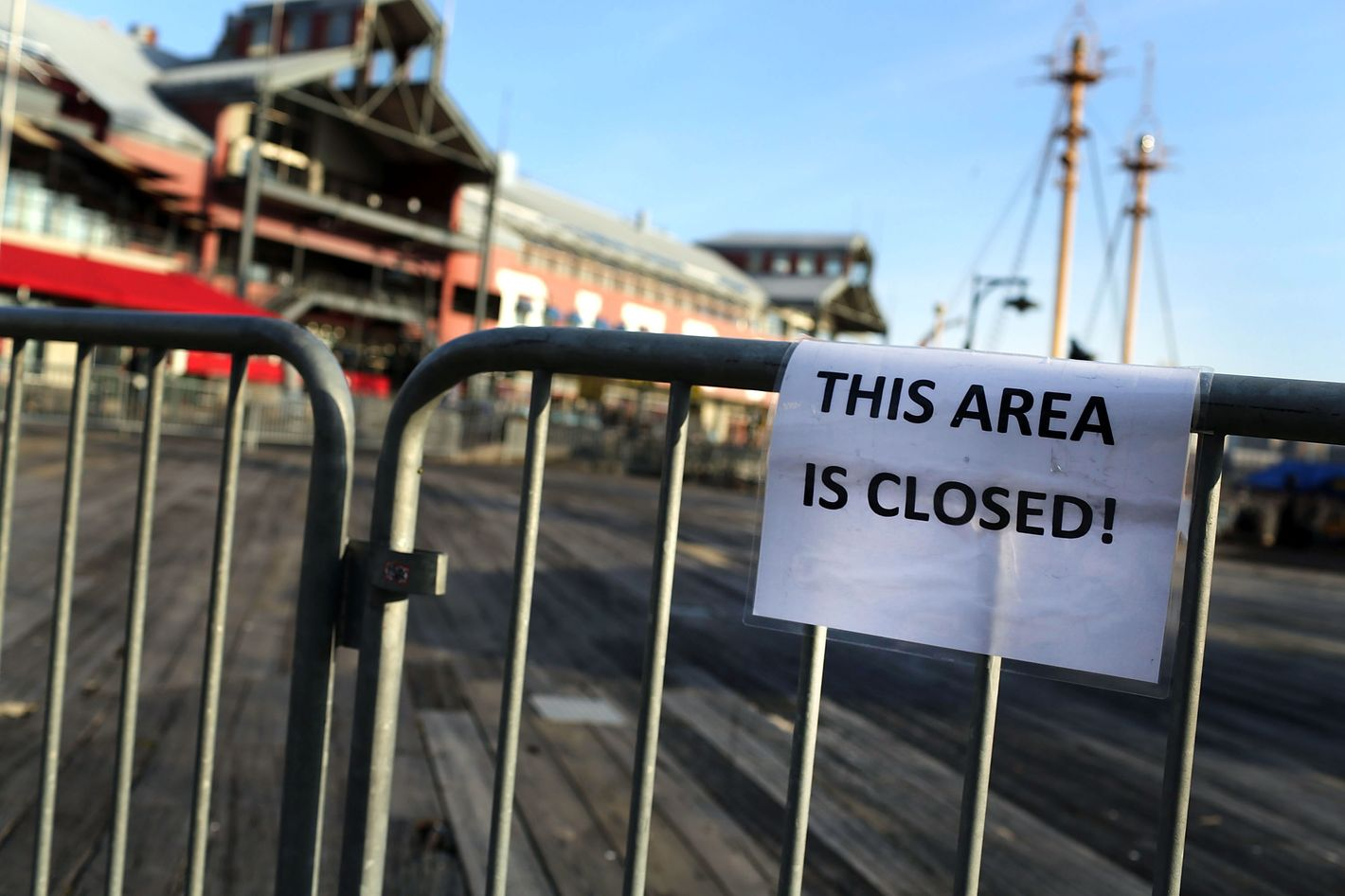 """A sign is posted that reads """"THIS AREA IS CLOSED!"""" on the flood damaged pier affected by Superstorm Sandy at South Street Seaport is closed and empty of tourists on December 3, 2012 in New York City. South Street Seaport, an area popular with tourists which was about to go through a major redevelopment, suffered severe damage from Hurricane Sandy. Most of the buildings and businesses, including the South Street Seaport Museum, suffered severe flooding and remained closed. According to a new Siena Research Institute poll, most New Yorkers overwhelmingly agree that climate change was behind Hurricane Sandy."""