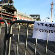 "A sign is posted that reads ""THIS AREA IS CLOSED!"" on the flood damaged pier affected by Superstorm Sandy at South Street Seaport is closed and empty of tourists on December 3, 2012 in New York City. South Street Seaport, an area popular with tourists which was about to go through a major redevelopment, suffered severe damage from Hurricane Sandy. Most of the buildings and businesses, including the South Street Seaport Museum, suffered severe flooding and remained closed. According to a new Siena Research Institute poll, most New Yorkers overwhelmingly agree that climate change was behind Hurricane Sandy."