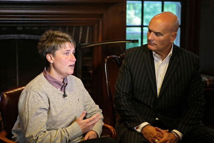 Jennifer Cramblett is interviewed at the home of her attorney, Tim Misny, right, in Waite Hill, Ohio Wednesday, Oct. 1, 2014. Cramblett has sued a Chicago-area sperm bank after she became pregnant with sperm donated by a black man instead of a white man as she'd intended.