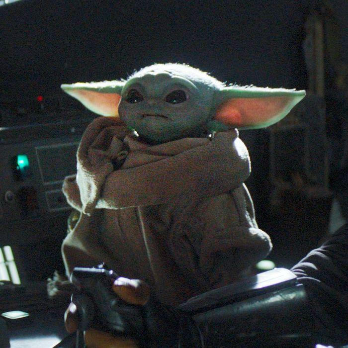 Baby Yoda flipping a switch in The Mandalorian.