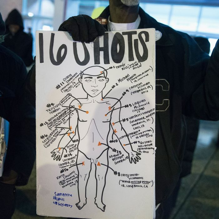 Protester with a poster depicting Laquan McDonald's autopsy results.