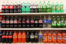 NEW YORK, NY - MAY 31: Two-liter bottles of regular and diet soda are seen for sale at a Manhattan store on May 31, 2012 in New York City. New York City Mayor Michael Bloomberg is proposing a ban on sodas and sugary drinks that are more than 16 ounces in an effort to combat obesity. Diet sodas would not be covered by the ban and many grocery stores would be exempt. (Photo by Mario Tama/Getty Images)