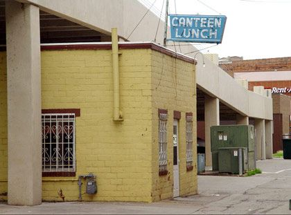 "<b></b>  <b>The Destination:</b> Canteen Lunch in the Alley in Ottumwa<b></b>  <b>How to Get There: </b>45 minutes south of I-80 between Iowa City and Des Moines.<b></b>  <b>When to Go:</b> Monday through Saturday, lunch through early evening.     This tiny Depression-era diner is a testament to the little guy standing up to the big shots. Many people think of ""loosemeat"" burgers as synonymous with the Maid-Rite chain, but the Canteen's version, which dates back to 1936, has its own fervent following, as do the malts and pies and the ladies who serve them — just don't try to order two burgers, because they'll only give you one at a time to ensure freshness. When the city wanted to build a parking garage that would have forced the Canteen to move, there was such an outcry from locals that the city built the garage over it, leaving the quaint diner hunkered in the shadows of charmless concrete. But at least it's safe now — it's on the National Register of Historic Places.    <i><b></b></i>  <i>Canteen Lunch in the Alley, 112 E. 2nd St., Ottumwa, 52501</i>"
