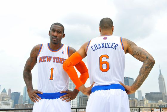 NEW YORK -  September 6: Tyson Chandler #6 and Amar'e Stoudemire of the New York Knicks unveil new uniforms on September 6, 2012 in New York City. NOTE TO USER: User expressly acknowledges and agrees that, by downloading and or using this photograph, User is consenting to the terms and conditions of the Getty Images License Agreement. Mandatory Copyright Notice: Copyright 2012 NBAE  (Photo by David Dow/NBAE via Getty Images)