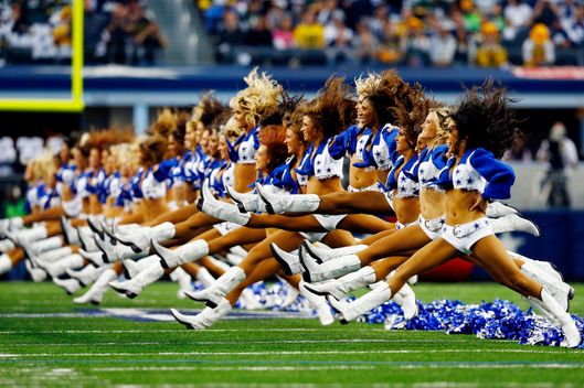 ARLINGTON, TX - DECEMBER 15:  Dallas Cowboys cheerleaders perform prior to a game against the Green Bay Packers at AT&T Stadium on December 15, 2013 in Arlington, Texas.  (Photo by Tom Pennington/Getty Images)