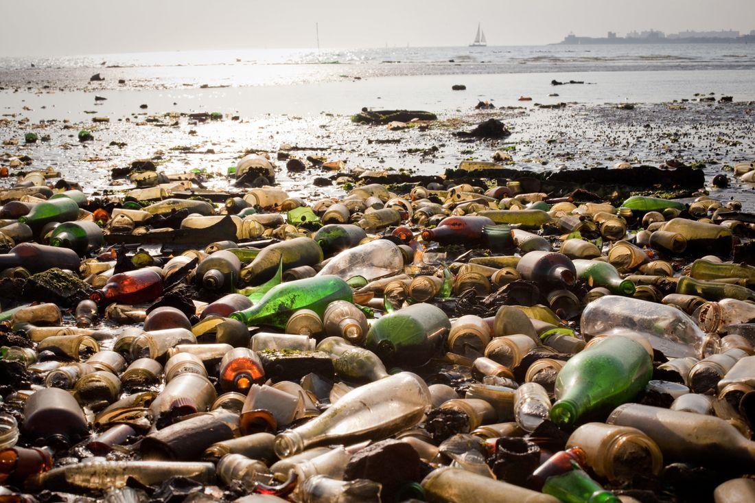 Hundreds of broken glass bottles line the sandy shores of Dead Horse Bay.