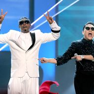 (L-R) MC Hammer and singer PSY perform onstage during the 40th American Music Awards held at Nokia Theatre L.A. Live on November 18, 2012 in Los Angeles, California.