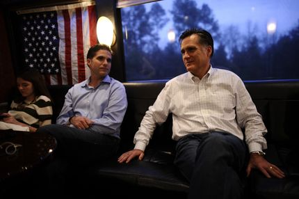 Republican presidential hopeful Mitt Romney rides his campaign bus between Gilbert and Charleston, South Carolina, January 20, 2012. South Carolina will hold its Republican primary on January 21, 2012. (L-R)  granddaughter Allie and son Tagg.