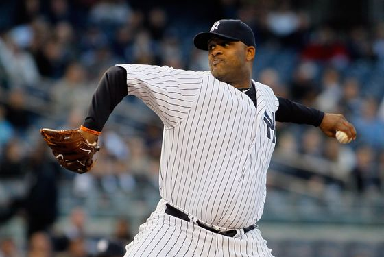NEW YORK, NY - MAY 10: CC Sabathia #52 of the New York Yankees delivers a pitch in the first inning against the Tampa Bay Rays at Yankee Stadium on May 10, 2012 in the Bronx borough of New York City.  (Photo by Mike Stobe/Getty Images)
