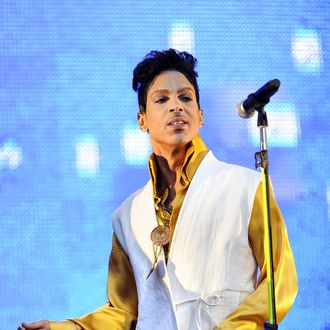 US singer and musician Prince (born Prince Rogers Nelson) performs on stage at the Stade de France in Saint-Denis, outside Paris, on June 30, 2011.