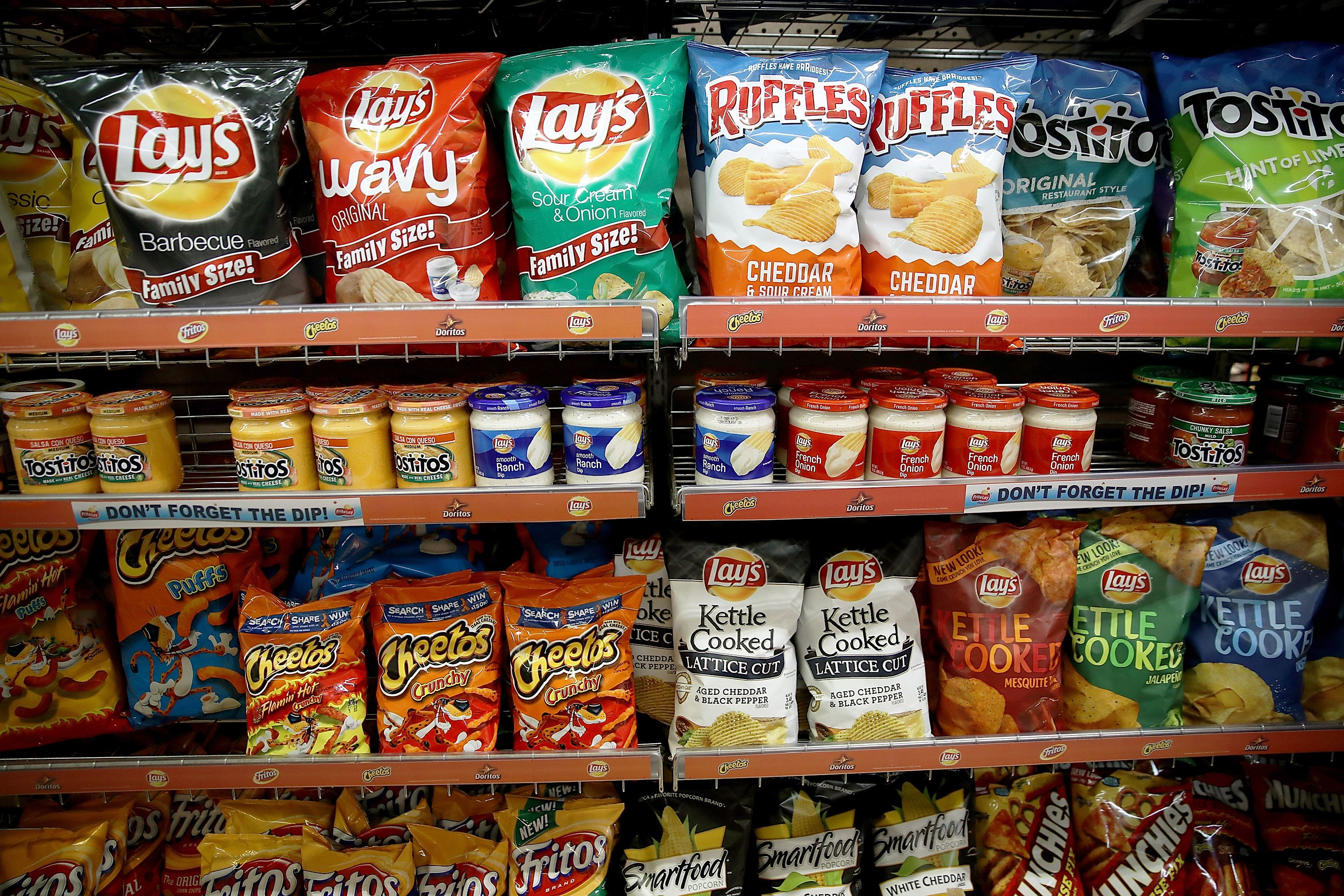 Bags Frito Lay chips are displayed on a shelf at Santa Venetia Market on July 11, 2017 in San Rafael, California. PepsiCo reported a better-than-expected second quarter earnings with revenue of $15.71 billion that was fueled by price hikes in its Frito Lay snack division.