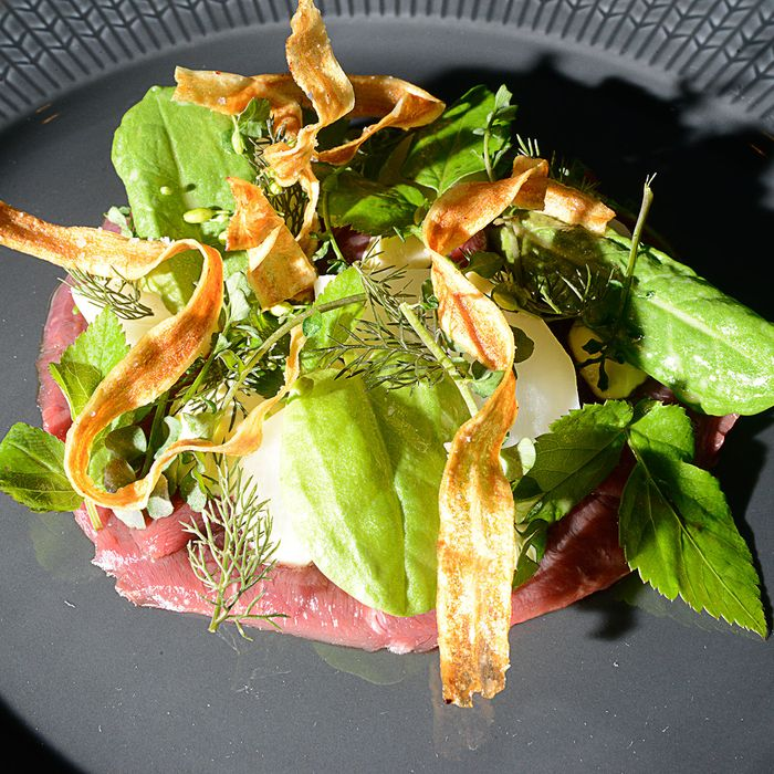 Raw beef heart with pickled onions, salsify mayonnaise, and sumac.