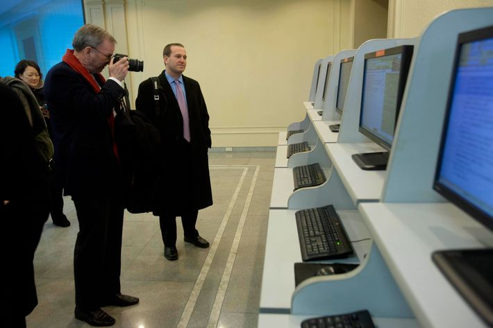 Executive Chairman of Google, Eric Schmidt, takes photographs as he tours a computer lab at Kim Il Sung University in Pyongyang, North Korea on Tuesday, Jan. 8, 2013. Schmidt is the highest-profile U.S. executive to visit North Korea - a country with notoriously restrictive online policies-since young leader Kim Jong Un took power a year ago.