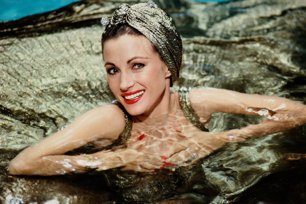 "LONG BEACH, CA - 1986:  Actress Jane Seymour poses while swimming in the Queeen Mary's pool during a 1986 portrait session in Long Beach, California. Seymour was on location filming the TV mini-series ""Crossings."" (Photo by George Rose/Getty Images)"