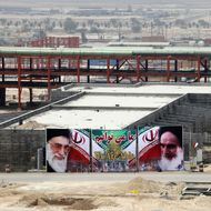 A huge banner bearing portraits of Iran