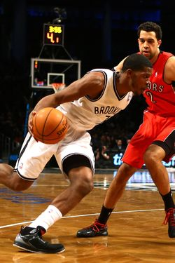 Brooklyn Nets shooting guard Joe Johnson #7 drives against Toronto Raptors small forward Landry Fields #2 during their game at the Barclays Center on January15, 2013 in the Brooklyn borough of New York City.