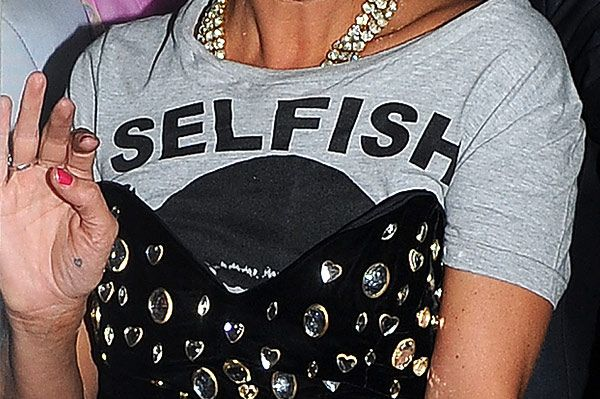 Supermodel Kate Moss wearing a grey top with the words selfish and a black dress, leaving The Box Club at 4.30am via the back door after attending Fran Cutler's 50th birthday party.