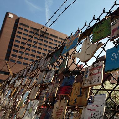 NEW YORK - APRIL 07:  Hundreds of ceramic plates pay homage to the victims of the September 11 attacks on a fence next to St. Vincent's Hospital, the hospital closest to the World Trade Center and which treated more than 800 people on 9/11, April 7, 2010 in New York City.  On Tuesday the board of St. Vincent Catholic Medical Centers voted to close the hospital following its unsuccessful search to find a way out of its estimated $700 million of debt. The Westside hospital, which has served Manhattan for 160 years, may retain some of its services like an urgent care facility.  (Photo by Spencer Platt/Getty Images)