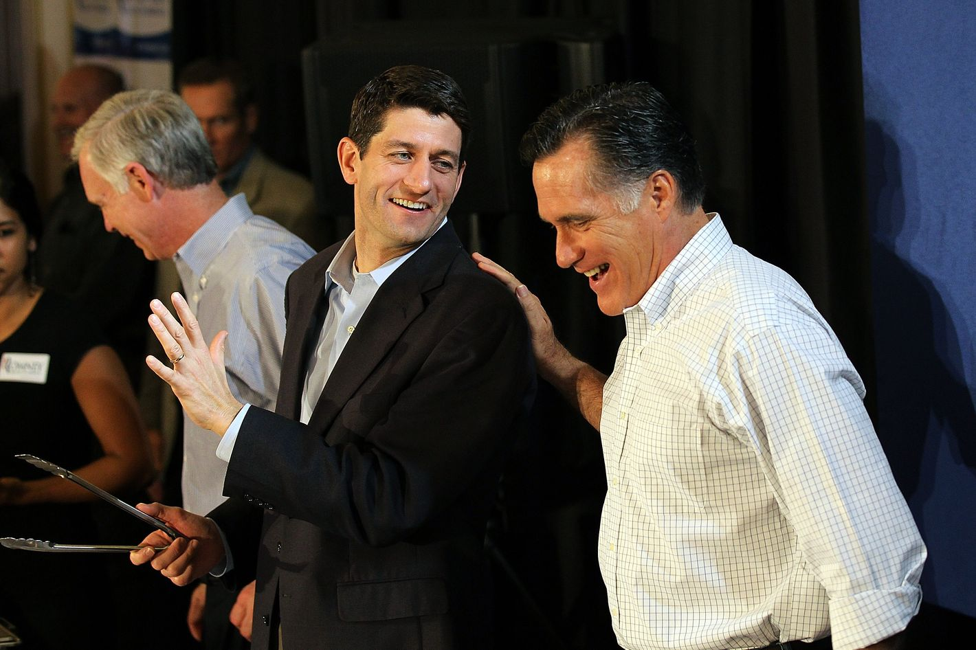 MILWAUKEE, WI - APRIL 01:  Republican Presidential candidate, former Massachusetts Gov. Mitt Romney (R) jokes with U.S. Rep Paul Ryan (C) (R-WI) during a pancake brunch at Bluemound Gardens on April 1, 2012 in Milwaukee, Wisconsin. With less than a week before the Wisconsin primary, Mitt Romney continues to campaign through the state.  (Photo by Justin Sullivan/Getty Images)