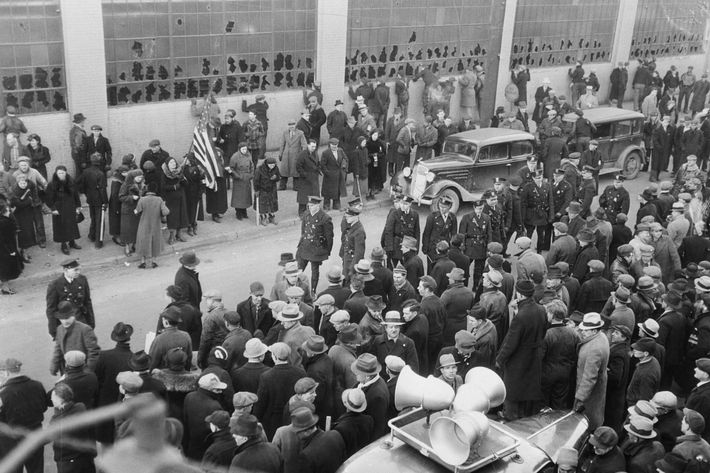 02 Feb 1937, Flint, Michigan, USA ---Here is the scene at Chevrolet Parts Plant No. 9, in Flint,where 12 persons were injured as Union Pickets,including about 75 women clashed w/ Company police in the latest outbreak of violence in the sit-down automobile strike.Sheriff Thomas Wolcott has demanded National guardsmen to prevent further trouble. The strikers' sound truck which sounded the call to arms is in the foreground. Police used tear gas against Pickets' stones and clubs.