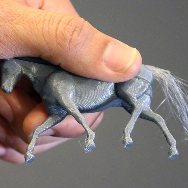 3-D hair printed on a toy horse.
