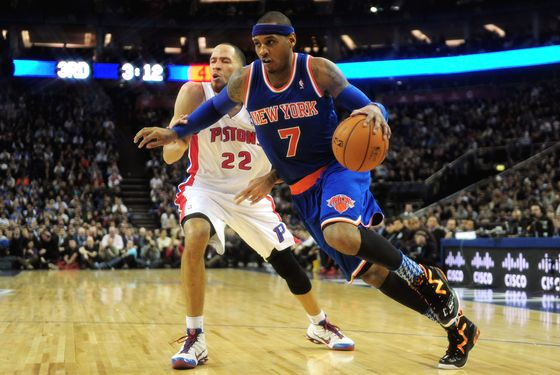 Carmelo Anthony of New York Knicks battles with Tayshaun Prince of Detroit Pistons during the NBA London Live 2013 game between New York Knicks and the Detroit Pistons at the O2 Arena on January 17, 2013 in London, England.