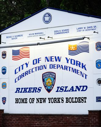 A sign of Rikers Island, where IMF head