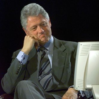 WASHINGTON, : US President Bill Clinton looks at the computer screen as he participates in the Democratic Leadership Council/Excite On Line Town Hall Meeting late 08 November 1999 at the Marvin Center Auditorium at George Washington University. The town hall meeting was conducted over the internet. (ELECTRONIC IMAGE) AFP Photo by Paul J. Richards (Photo credit should read PAUL J. RICHARDS/AFP/Getty Images)
