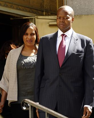 Nafissatou Diallo (L), the hotel maid that accused former International Monetary Fund chief Dominique Strauss-Kahn of sexually assaulting her in a New York City hotel, and her attorney, Kenneth Thompson (R) leave the courthouse after meeting with prosecutors in New York on August 22, 2011. Thompson suggested Monday that the charges against the one-time French presidential hopeful had been dropped, after a key meeting in New York.
