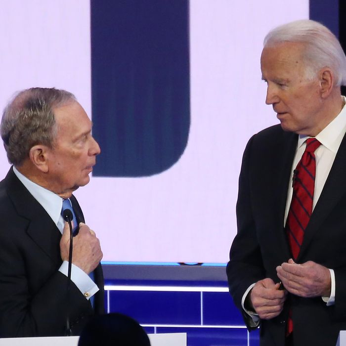 Democratic presidential candidates former New York City mayor Mike Bloomberg (L) and former Vice President Joe Biden speak during a break during the Democratic presidential primary debate at Paris Las Vegas on February 19, 2020 in Las Vegas, Nevada.