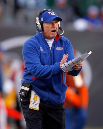 Head coach Tom Coughlin of the New York Giants yells to his team during the second quarter of a game against the New York Jets at MetLife Stadium on December 24, 2011 in East Rutherford. New Jersey.