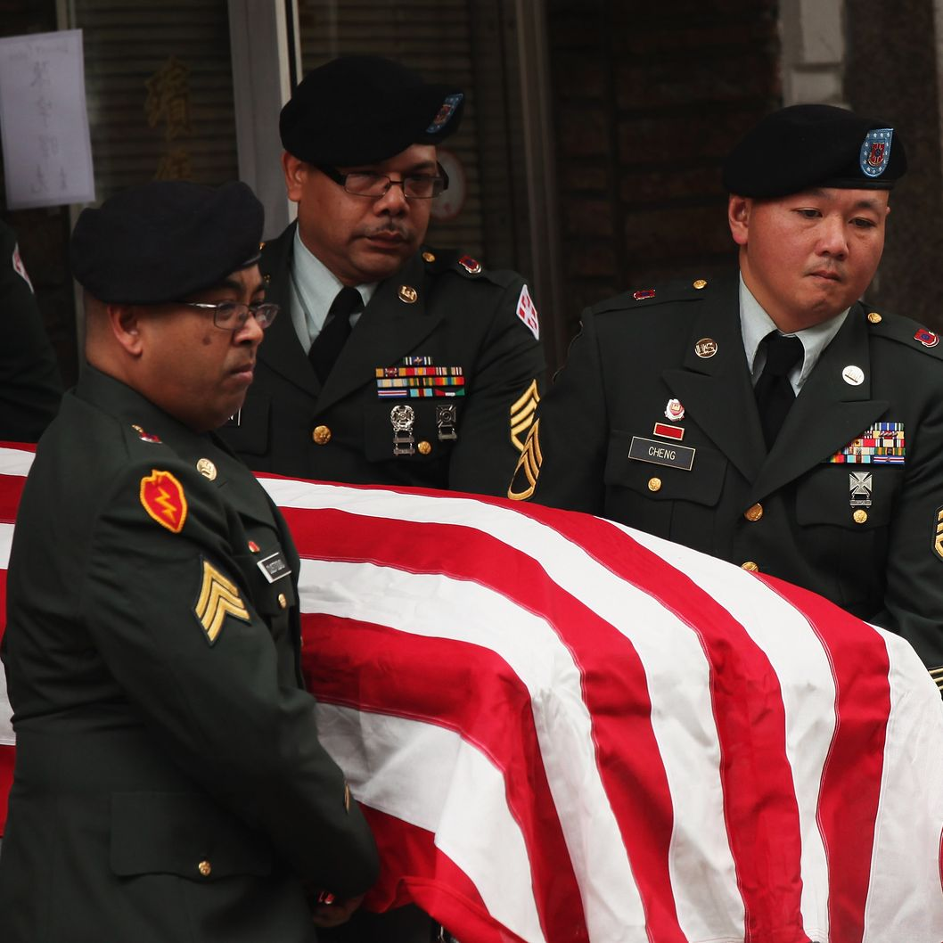 NEW YORK, NY - OCTOBER 13:  Soldiers carry the casket of Army Pvt. Danny Chen in Chinatown on October 13, 2011 in New York City. Pvt. Chen who had been in Afghanistan for two months, was found dead with a gunshot wound below his chin on Oct. 3. While preliminary signs suggest Pvt.. Chen killed himself, the U.S. Army has told the soldiers parents that he was subjected to taunting and violence by some of the soldiers with whom he served with.  (Photo by Spencer Platt/Getty Images)
