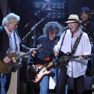 (L-R) Musicians Frank Sampedro, Billy Talbot, Neil Young, and Ralph Molina of the band Crazy Horse perform onstage on February 10, 2012 in Los Angeles, California.